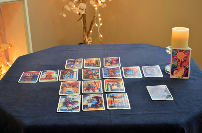 Tarot cards laid out in a classic spread on Karen's table