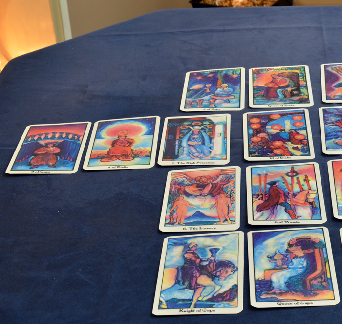 Close-up shot of Tarot cards spread, which gives Karen insight into your life