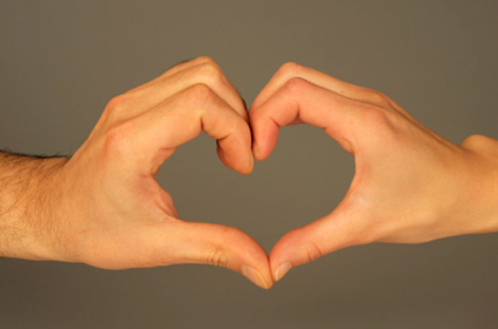 Two hands making a heart - relationships are what spirit blesses us with